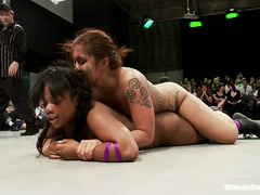 Four strong, nearly nude ladies fight it out on the wrestling match