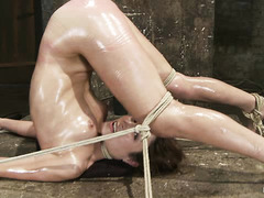 Amber Rayne squeals as she's tied up, whipped and fucked with dildos