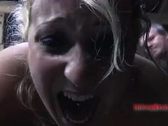 A blonde babe is choked with plastic before having her cunt pounded