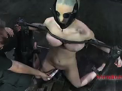 A young chick is used as a human ashtray by an older, commanding Dom