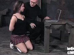 A short-haired brunette is whipped, caned and dildo fucked by an older guy