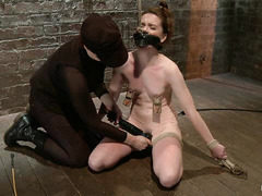 Redhead hottie AnnaBelle Lee is tied down and whipped by her Mistress