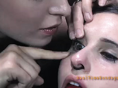 A bound girl has her head and eyebrows shaved before being caned