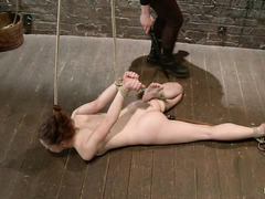 AnnaBelle Lee is bound by her hair by a Domme who loves to whip