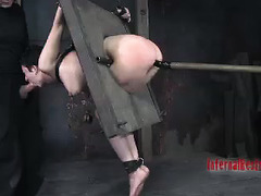 A brunette is tag-teamed by two punishing Doms who love fucking her