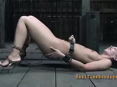 A helpless slave is tortured with water, clamps, toys and her Masters