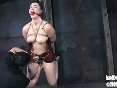 A slender honey experiences extreme titty torture during a BDSM session