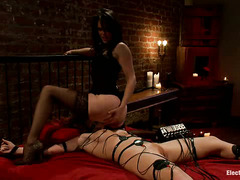 Brooklyn Lee struggles and writhes as her bound body is shocked