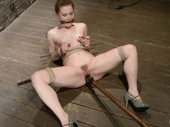 Bound redhead AnnaBelle Lee cries out as her pussy is fucked and pumped