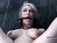 A short-haired beauty is bound and teased until she squirts and cries