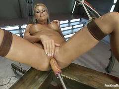 Blonde bombshell Nicole Graves pleasures her pussy with fucking machines