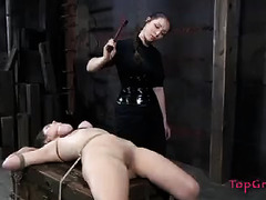 This brunette is forced to give up control during lezdom bondage fun