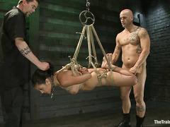 Slave babe Adrianna Luna sucks cock while the whip burns her back