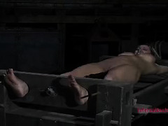 Stretched taut, this blonde babe can't escape her Master's punishment