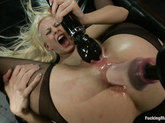 Jessie Volt puts thrusting dildos into her wet cunt and tight asshole