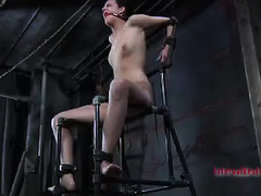 Held captive by brutal restraints, this babe is fucked and whipped