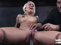 A busty blonde submits to her Master's painful BDSM punishments