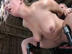A sexy and bound blonde is punished with fire, water and painful toys