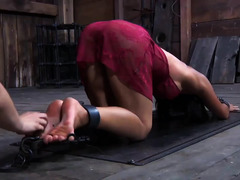 Shackled to the ground, a defenseless girl is whipped and tickled