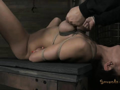Dominated babe chokes on cock while her nipples are squeezed