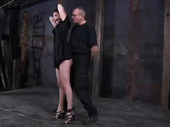 A restrained brunette cries out as a cane leaves bruises on her tender ass