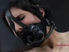 Harsh metal restraints keep this slave in place during punishment