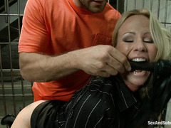 Warden Simone Sonay gets a rough pounding from a buff prisoner