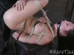 A sub with long hair and perky tits is tied, whipped and caned
