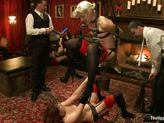 Horny guests enjoy taking these slaves during a kinky BDSM party