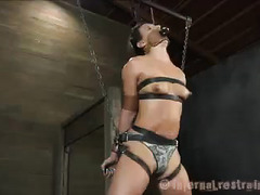 A strapped-up beauty experiences pain and torment before pleasure