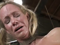 A beautiful blonde with big tits is brutally fucked while tied up