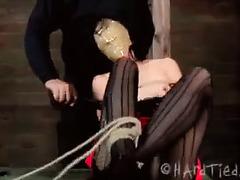 A blindfolded slut is severely punished by her relentless Master