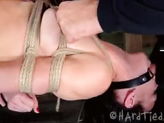 A blindfolded slut is severely punished by her relentless Master