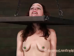 A humiliated chick struggles through a painful bondage session