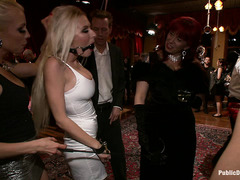 Partygoers have a great time fucking and fondling the beautiful Riley Evans