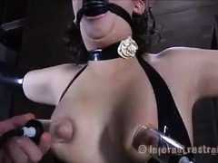 A squirming brunette endures a load of painful nipple torture
