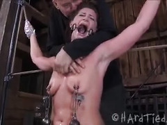 A tied-up and moaning babe is throat-fucked, caned and nipple clamped