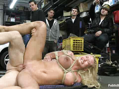 Blonde Leya Falcon is brutally banged by dudes at an auto garage
