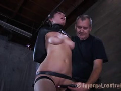 A strapped-down beauty fucked by a thick dildo while whipped