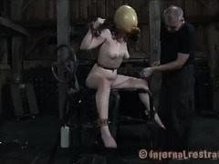A restrained brunette takes a dizzying session of pleasure and pain
