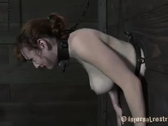 A sexy redhead can't see the punishment that's coming her way