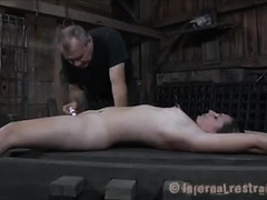 A young blonde writhes as she's locked up and made to cum many times