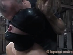 A blonde slut is punished while in an inescapable straight jacket