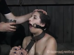 A brunette bound in metal is caned until she cries in pain
