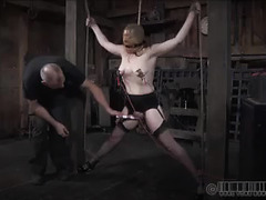 The pussy of a cute redhead is clamped, weighed down and tormented