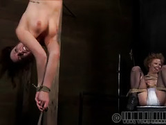 A sexy brunette endures excruciating pain from several fronts