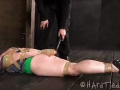 An unfortunate beauty is bound and tortured with electricity