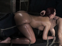 A fleshy and oiled-up brunette sucks cock while cumming hard
