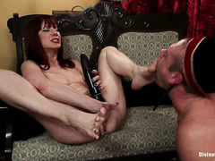 Maitresse Madeline seduces a hapless bellhop with her pretty feet