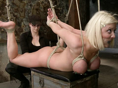 Cherry Torn is tied up and oiled before her tits are brutally bound